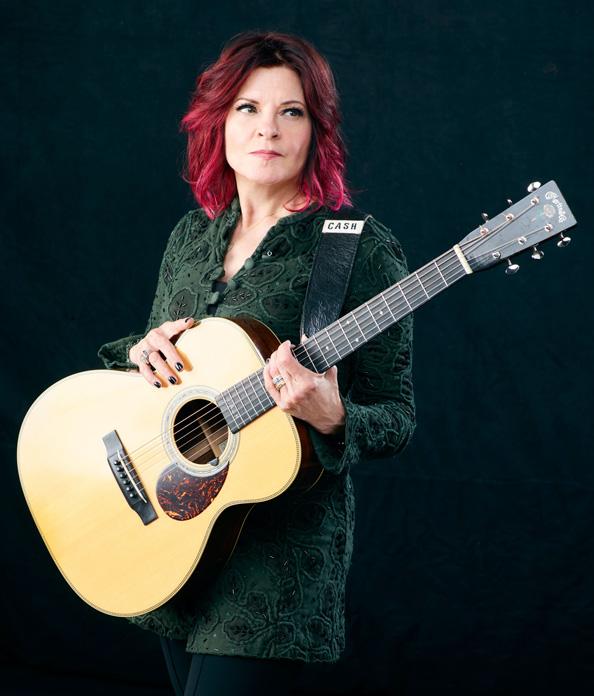 Rosanne Cash holding her guitar