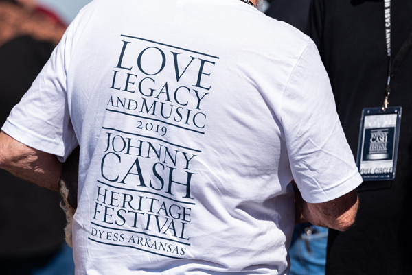 A white concert shirt with the logo