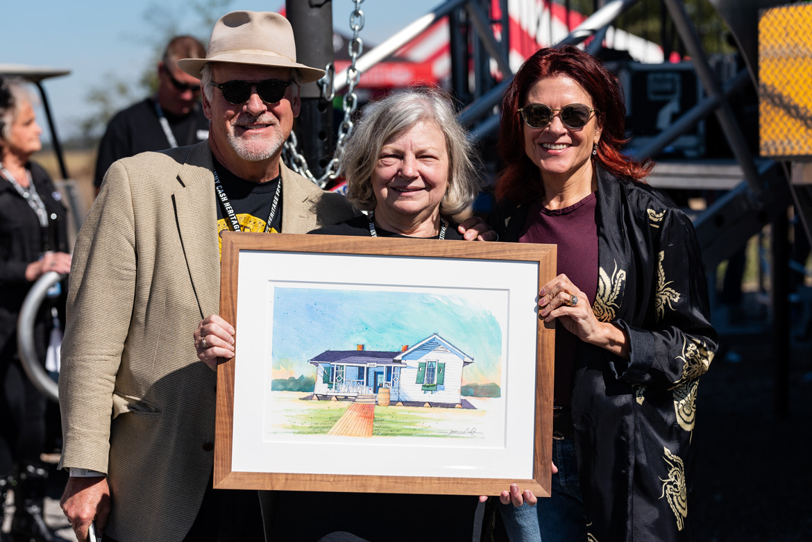 Ruth Hawkins is presented with a painting of the boyhood home